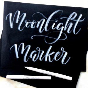 moonlight markers white brush tip pen for modern calligraphy on black paper example